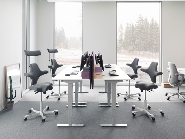 Grey HÅG Capisco office chair with headrest designed by peter opsvik ergonomic comfortable chair
