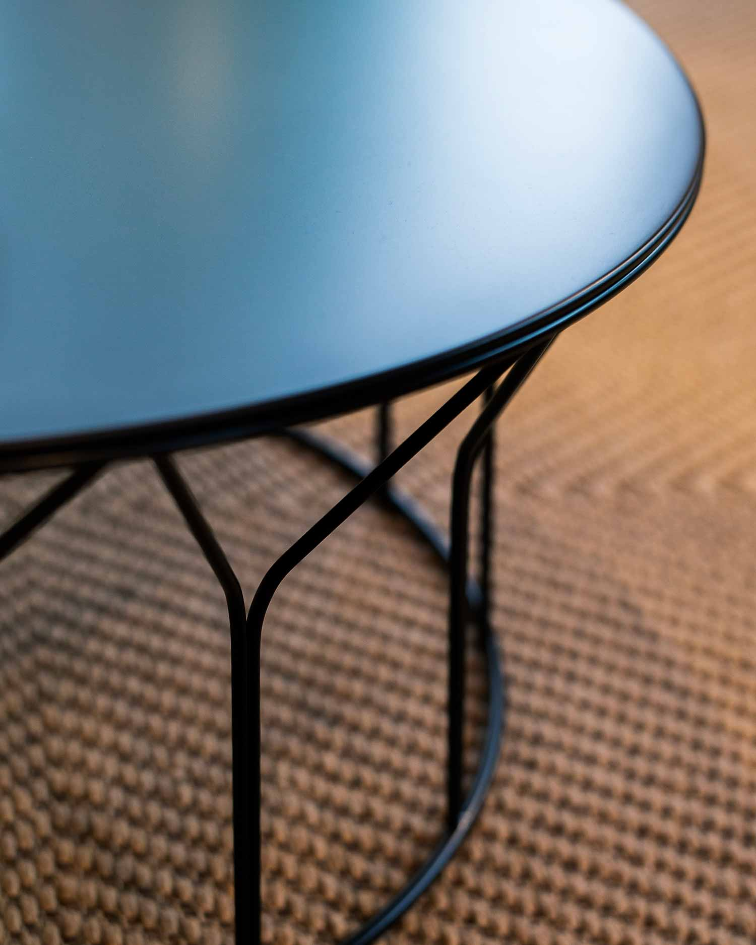 luxury designer table close up offecct circus table blue shiny surface top designers saturday oslo