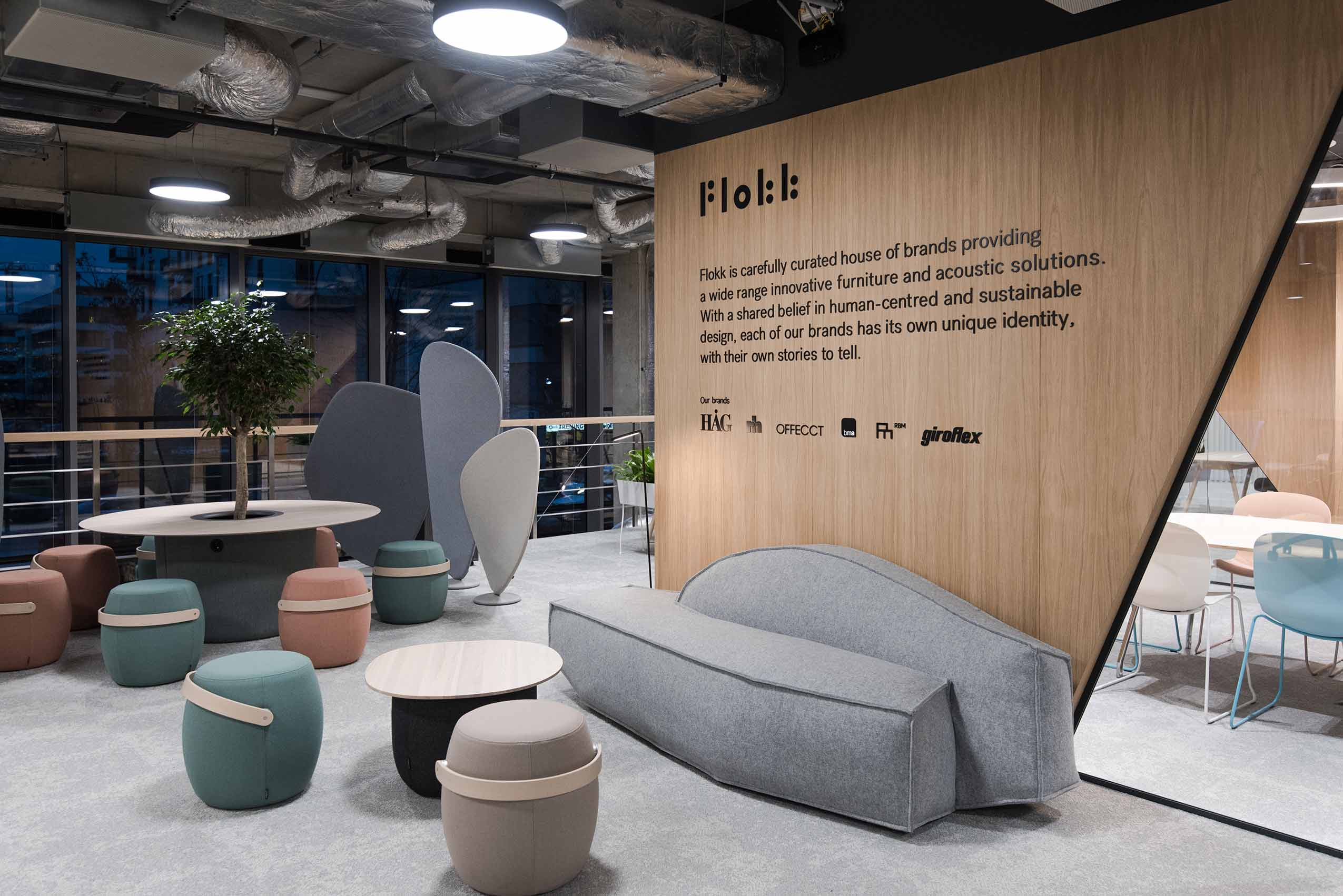 Flokk furniture showroom in poland warsaw scandinavian design led interior architecture grey offecct carry on stool and sofa