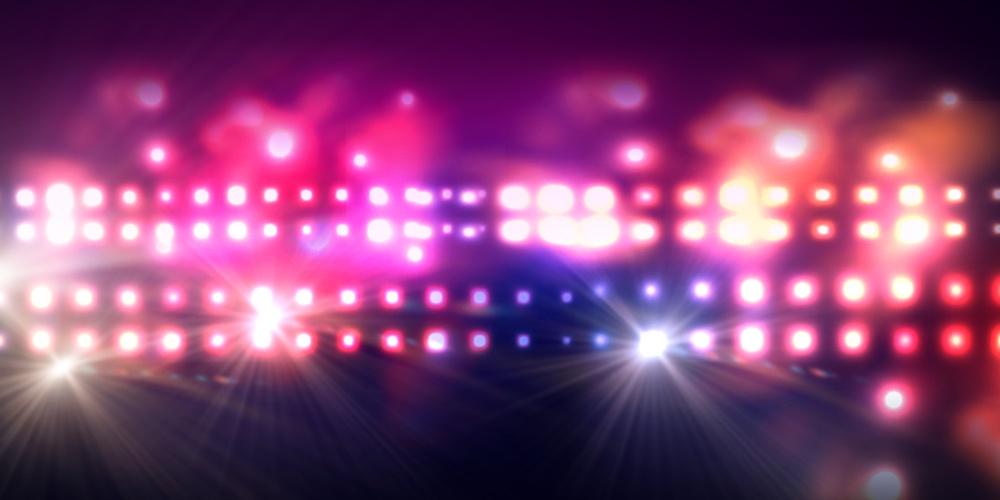 Background image of stage in color lights.jpeg