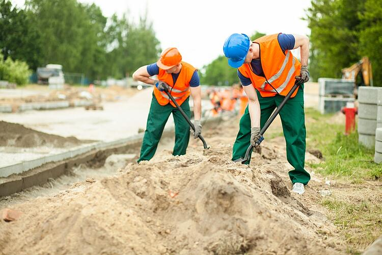 Image of construction workers digging on a road.jpeg
