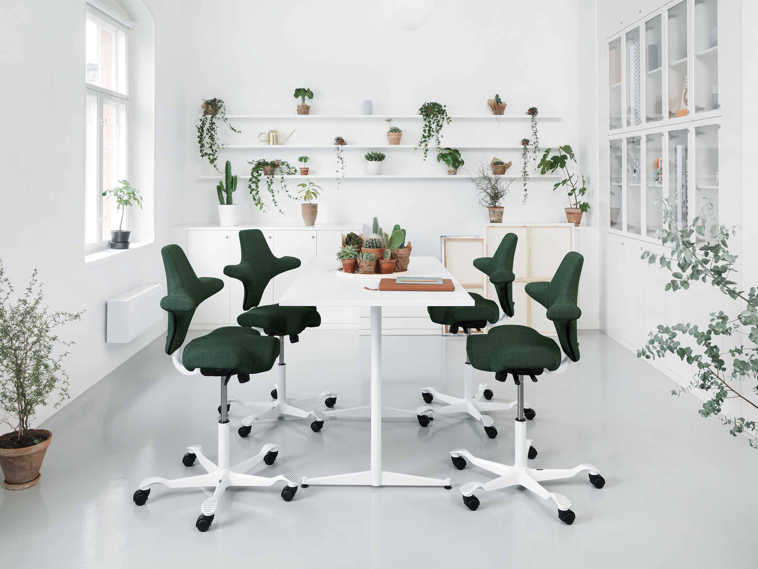 HÅG Capisco in Green  - designed by Peter Opsvik for Flokk