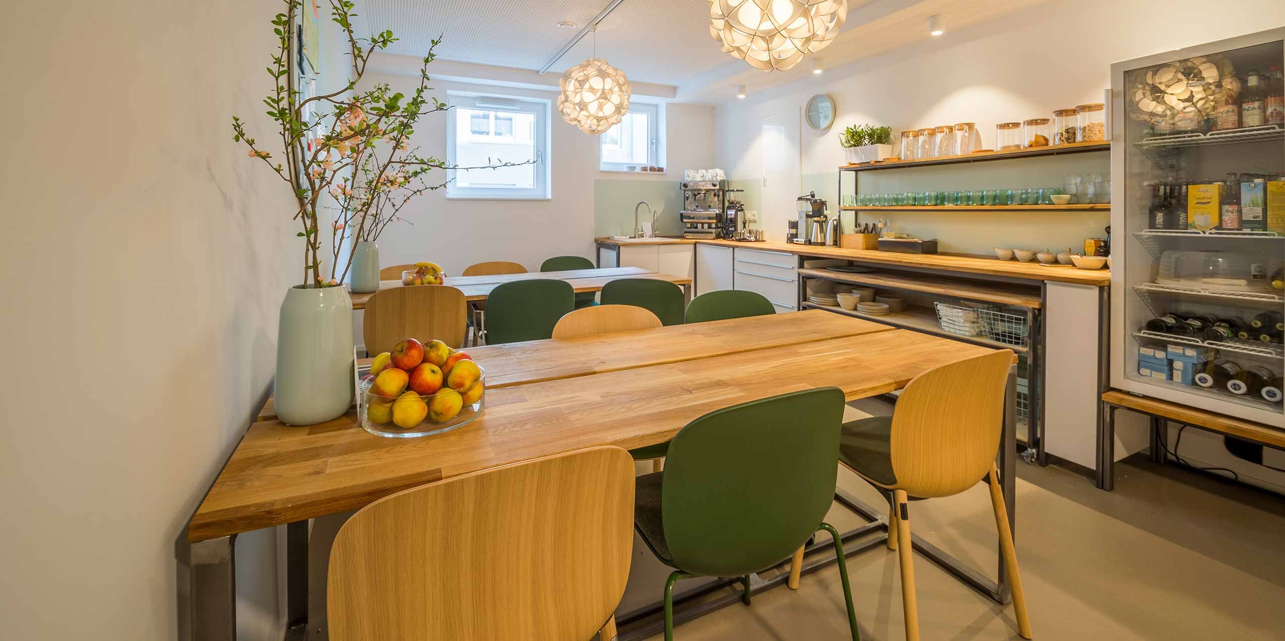 cowork office eating break room cafeteria wooden seating canteen kitchen tables and chairs